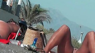Real amateur nudist hotties with naked pussy at the beach