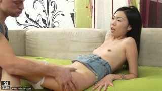 Skinny Asian brunette Yiki gets her pussy licked and ass fingered